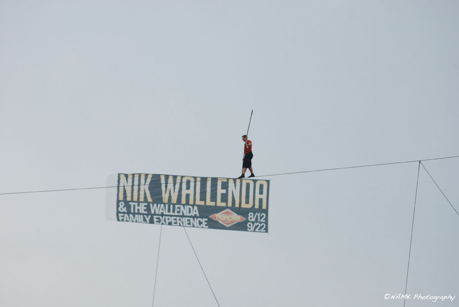 Nik walking across his banner